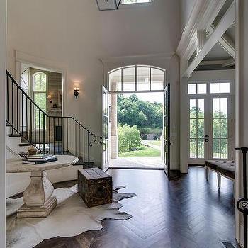 Charming 2 Story Foyer With Wood Herringbone Floors