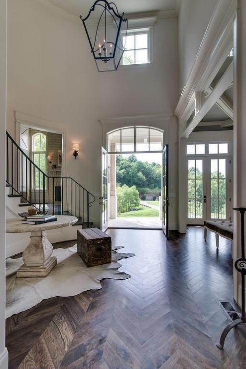 2 Story Foyer With Wood Herringbone Floors Cottage
