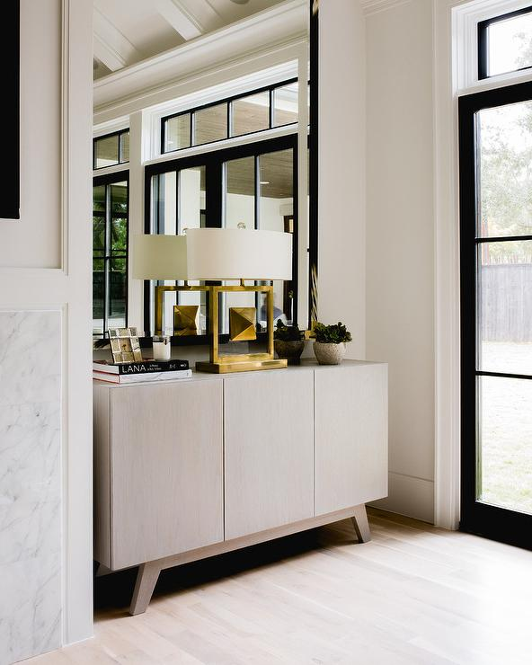 Foyer Mirror Cabinet : Gold oval mirror over gray credenza cabinet contemporary