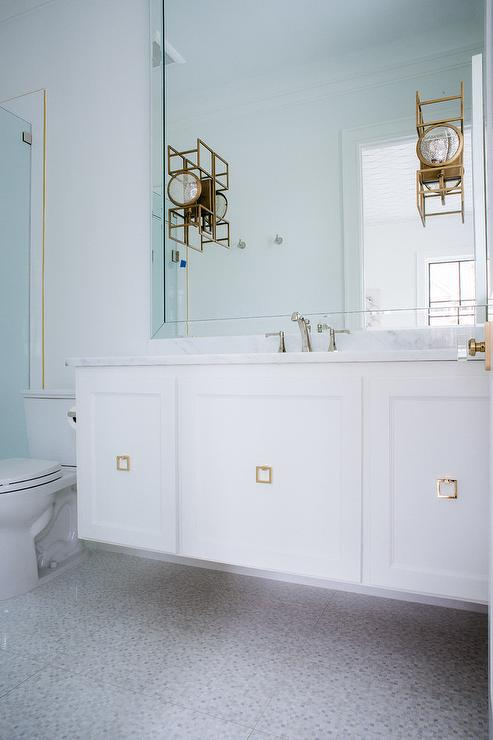 Exquisite White And Gold Contemporary Bathroom Is Equipped With A Floating Washstand Accented Square Brass Pulls Sink Polished
