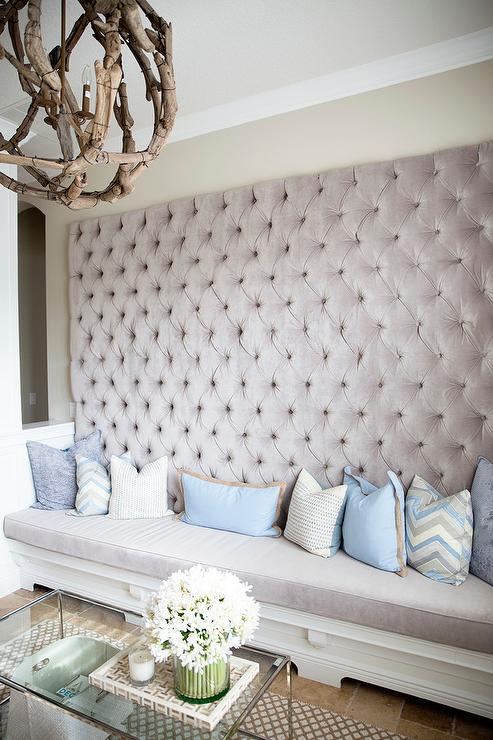 Gray Tufted Bench with Blue Pillows