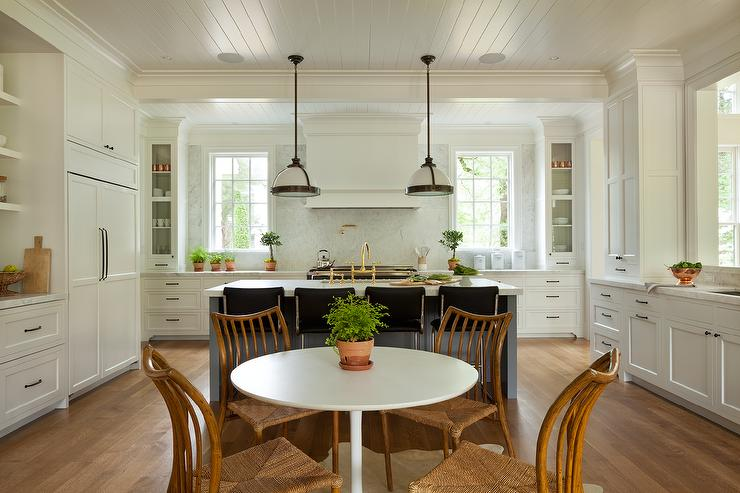 charming ushaped eatin kitchen boasts rush seat dining chairs positioned around an ikea docksta table located in front of a charcoal gray kitchen island - Seagrass Chairs