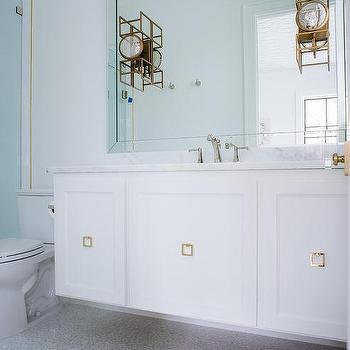 square brass pulls on floating sink vanity