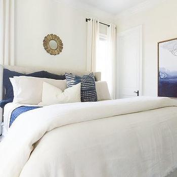 Blue And White Bedroom With Gold Sunburst Mirror