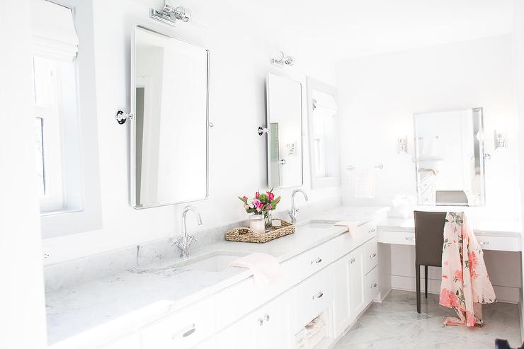 white makeup vanity with gray leather chair