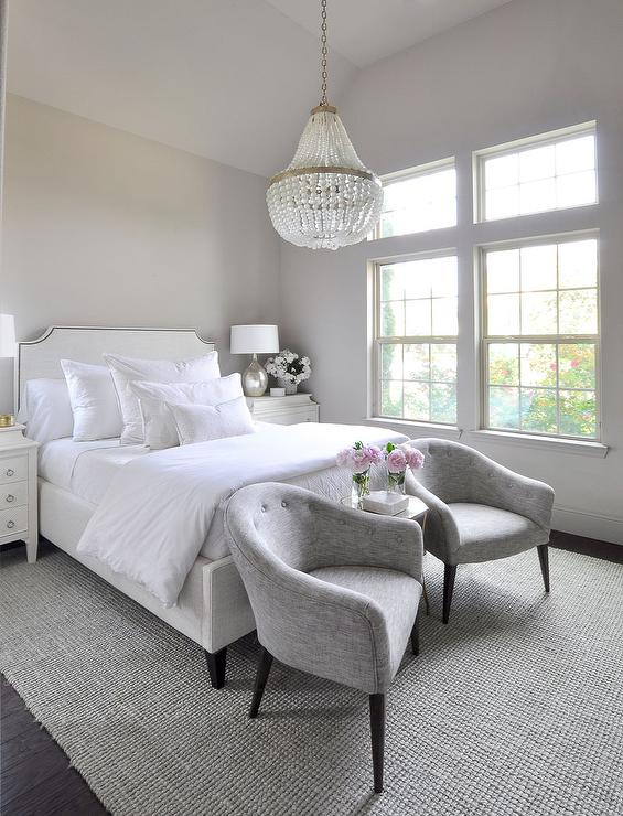 White Nailhead Sofa at End of Bed Transitional Bedroom
