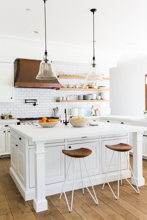 White Kitchen Vent Hood stacked wood shelves next to kitchen vent hood - transitional
