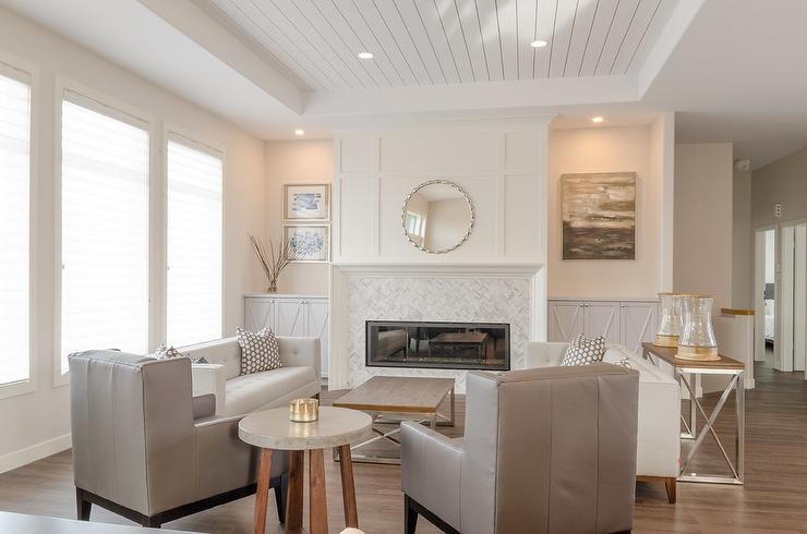 Under A White Shiplap Tray Ceiling An Exquisite And Gray Living Room Is Lit By Recessed Lighting Positioned Over Nickel Wood Coffee Table