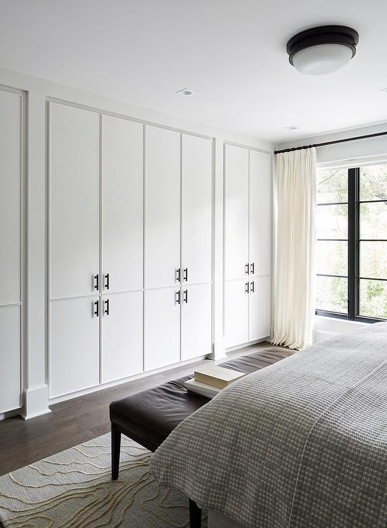 Wall Of Floor To Ceiling Closet Cabinets Modern Bedroom