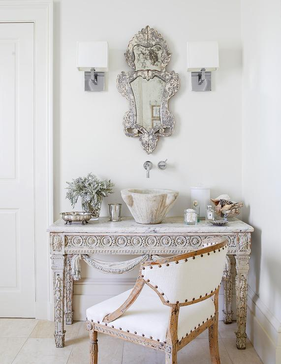 Custom Bathroom Design Features A French Table With A Marble Bowl Sink  Displaying Ornate Textures And Patterns.