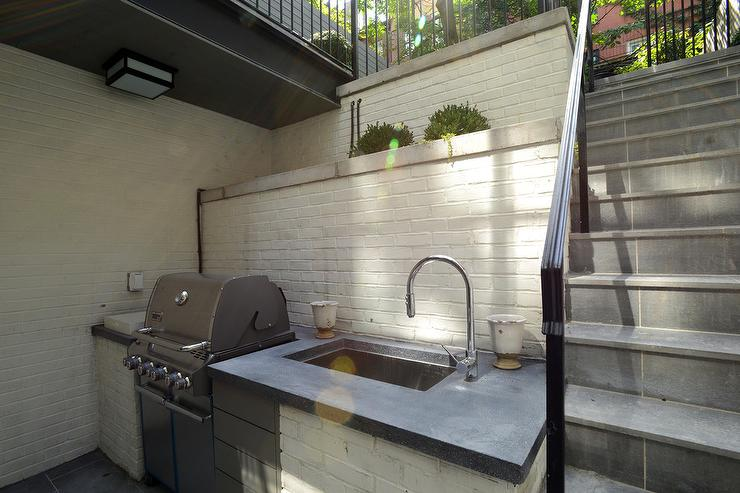 White Brick Outdoor KItchen with Concrete Counter ...