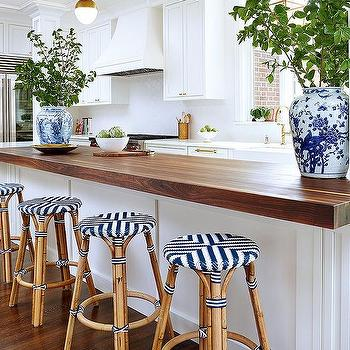 Amie Corley Interiors  Butcher Block Kitchen Peninsula with Backless  Rattan Stools