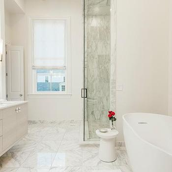 French Bathroom With Mirror And Brass Wall Sconces