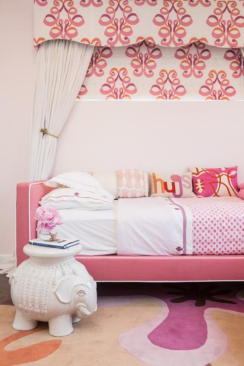 if your little girl loves pink sheu0027ll adore this girlu0027s bedroom fitted with a pink daybed accented with white piping and placed beneath a pink and orange