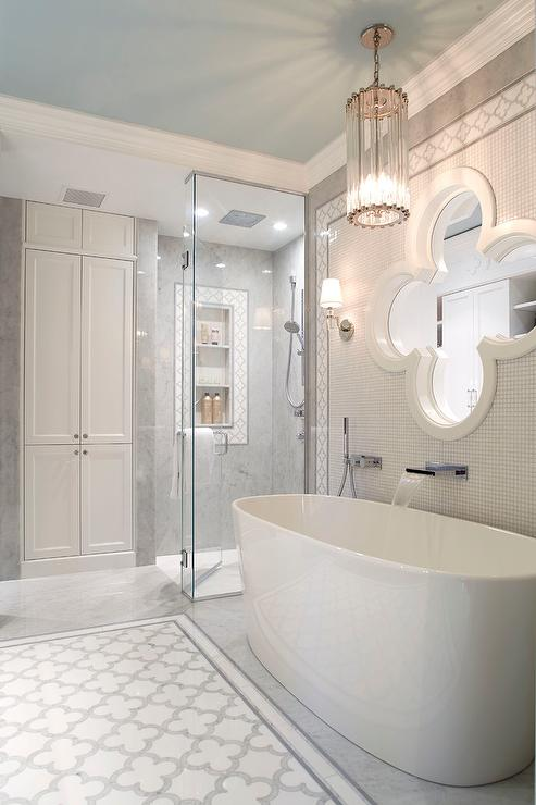 Quatrefoil Mirror Over Oval Bathtub - Transitional - Bathroom
