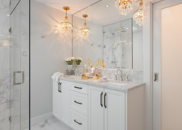 Brass And Crystal Droplets Chandeliers Over Dual Washstand
