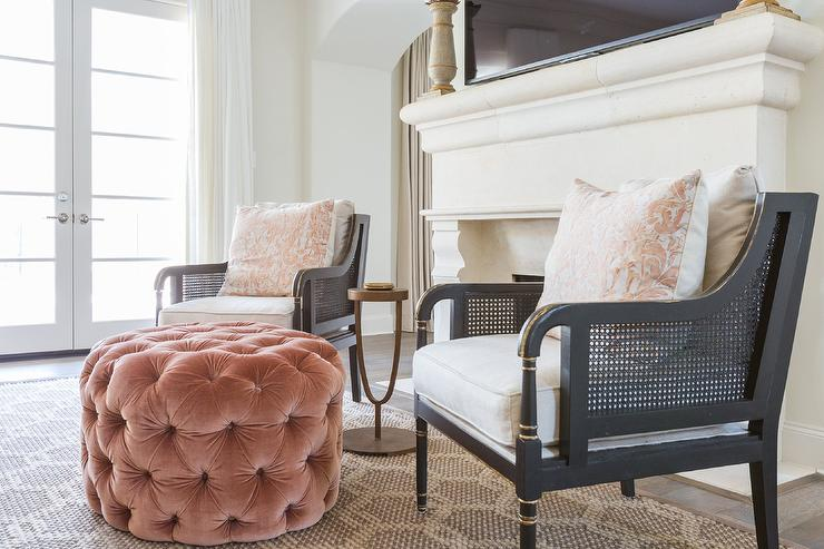 black cane chairs with round pink velvet tufted ottoman