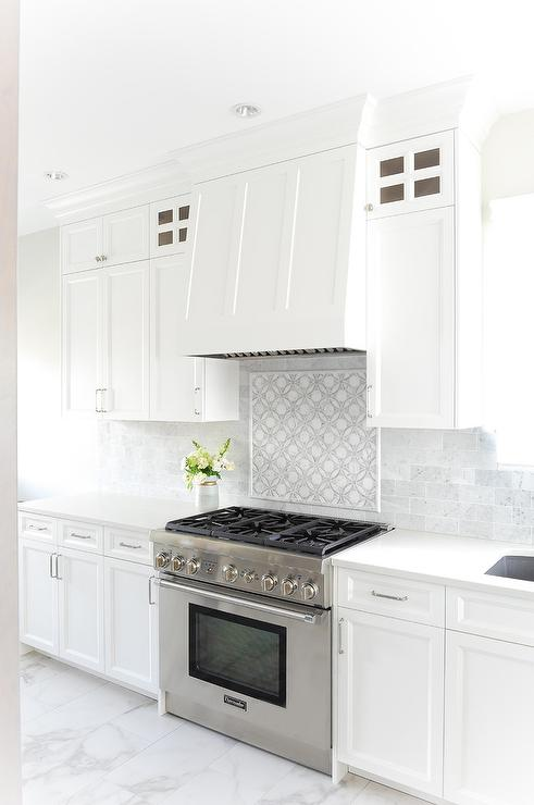 white and gray mosaic stove backsplash
