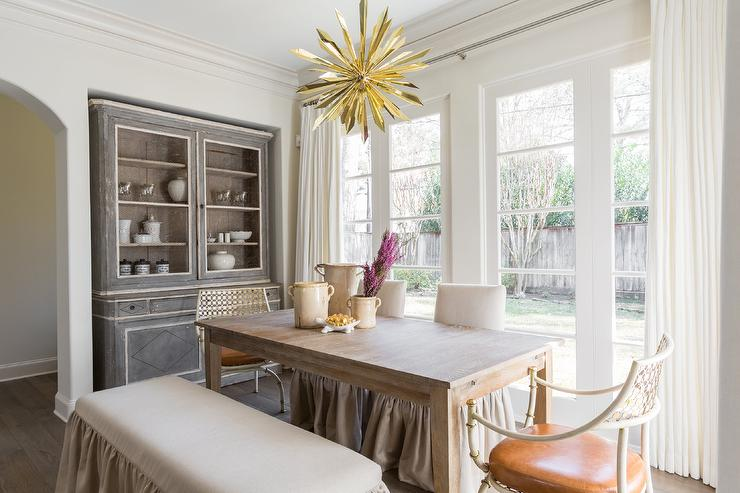 Gold Starburst Chandelier With Ruffled Dining Bench