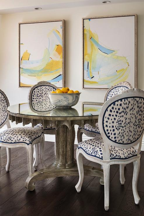 Brunschwig And Fils Les Touches Fabric Accents Round Back French Dining Chairs Placed Surrounding A Gray Mirror Top Table Positioned In Front