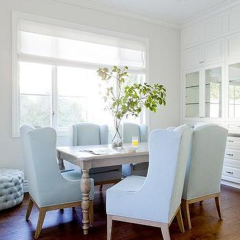 gray dining table with sky blue wingback dining chairs