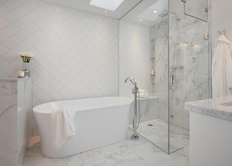 White Herringbone Tiles on Wall Behind Oval Bathtub - Transitional ...