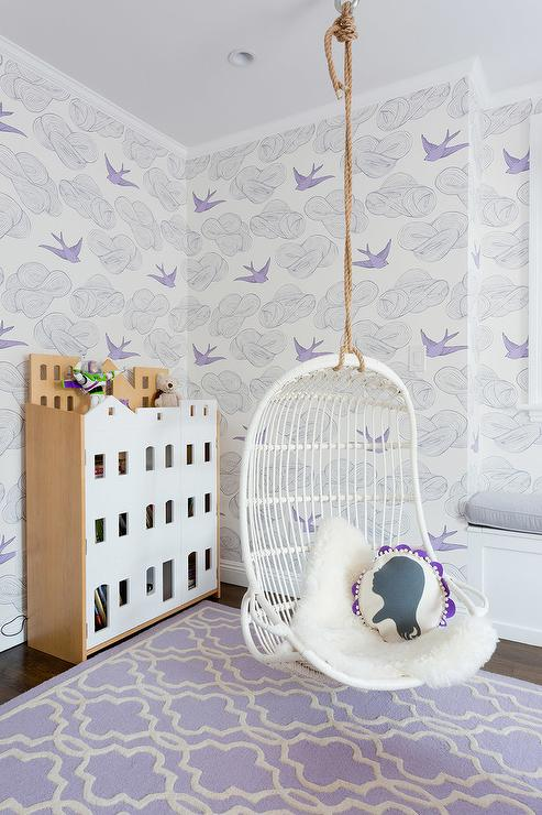 Charming White And Purple Girlu0027s Bedroom Is Clad In Hygge U0026 West Daydream  Wallpaper And Features A Serena U0026 Lily Hanging Rattan Chair Topped With A  White ...