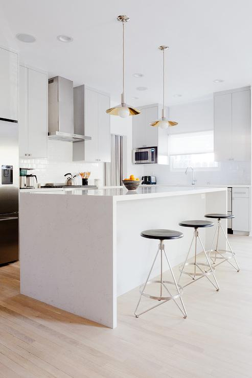 Modern Gray Kitchen With Round Chrome Counter Stools