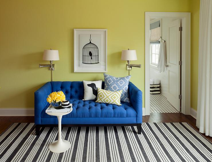 Contemporary Blue And Yellow Bedroom Is Furnished With A Tufted Sofa Placed On Black White Striped Rug Behind Mid Century Modern Accent