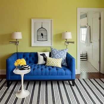 Blue Tufted Shelter Arm Sofa With Black And White Striped Rug