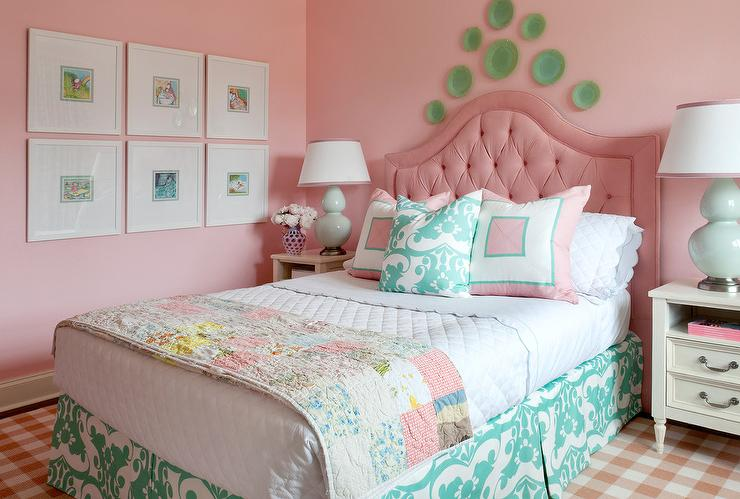White french bedside tables topped with celadon green lamp flank a pink  tufted headboard accenting a bed dressed in white scalloped bedding topped  with a ... - Pink Tufted Arch Girl Headboard Design Ideas