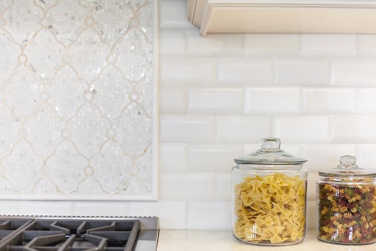 subway tiles create a fresh backsplash showcasing a white and ivory