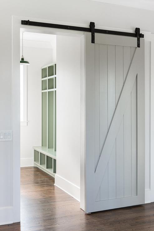 Gray Shiplap Barn Door On Rails Transitional Laundry Room