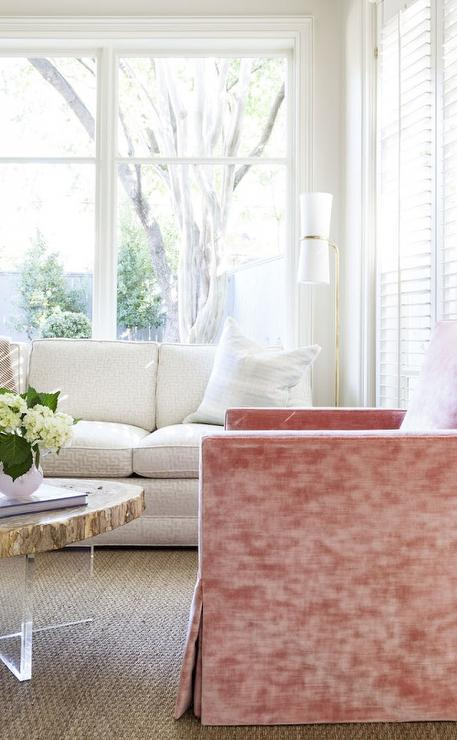 pink velvet chair with wood and lucite coffee table transitional