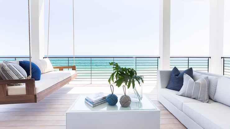 Alyssa Rosenheck   Chad James Group   Stunning Covered Beach Side Deck  Boasts A Bay Breeze Hanging Seat Topped With White Cushions Accented With  Blue And ...