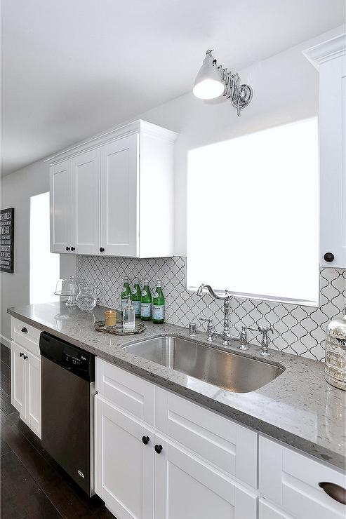 High Quality Well Appointed White Kitchen Features A Stainless Steel Dishwasher Fixed  Between White Shaker Cabinets Accented With Oil Rubbed Bronze Knobs And A  Gray ...