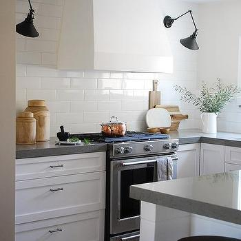 White Kitchen Vent Hood With Black Swing Arm Sconces