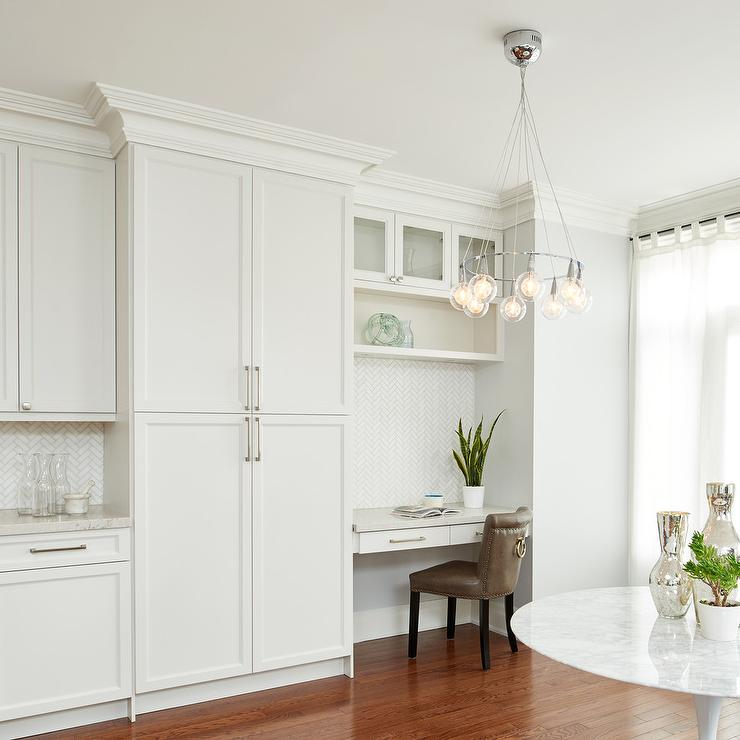 Bright White Kitchen Boasts A Small Work Station Ed With Brown Leather Desk Chair Placed Facing Floating Fixed Between Light Gray Wall