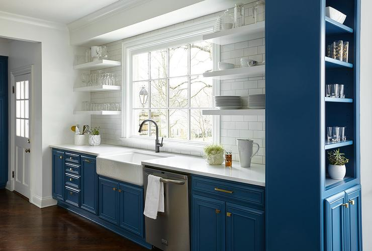 Stunning Tall Blue Bar Shelves Compliment Surround Raised Panel Cabinetry With Brass Hardware