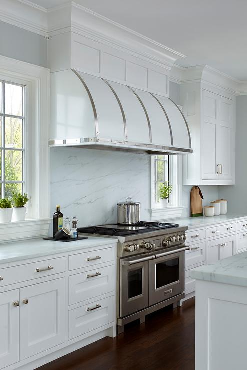 White Kitchen Vent Hood stainless steel straps on white barrel kitchen vent hood