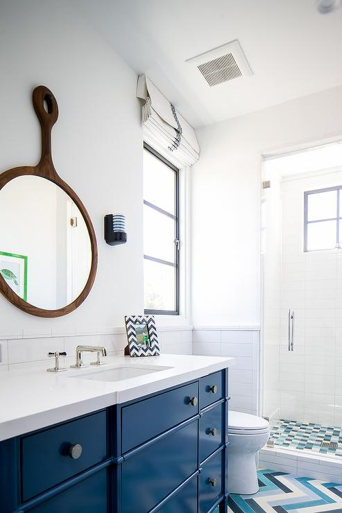 blue bath vanity with wood keyhole mirror