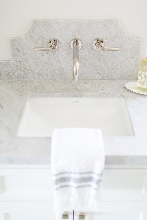 Kallista Sink Under Faucet Mounted on Curved Marble Backsplash ...