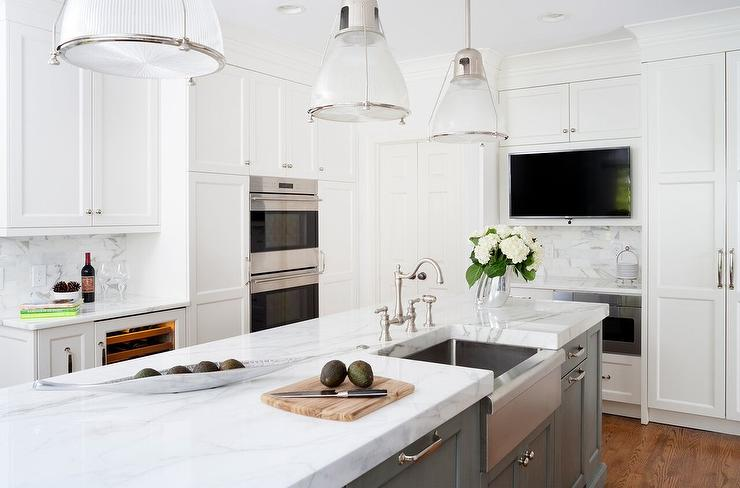Gray And White Kitchen Is Fitted With Three Hudson Valley Lighting  Haverhill Pendants Hung Above A Gray Center Island Finished With A  Stainless Steel Sink ...