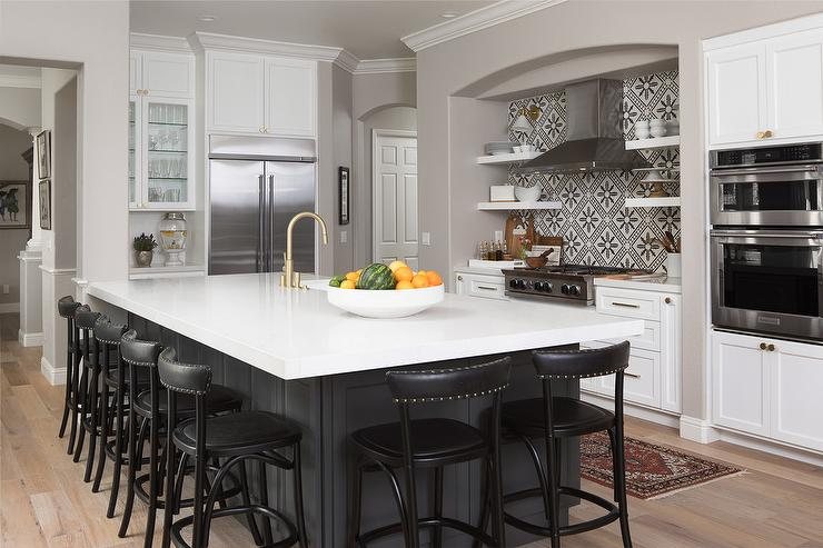 charcoal gray island with black counter stools transitional kitchen
