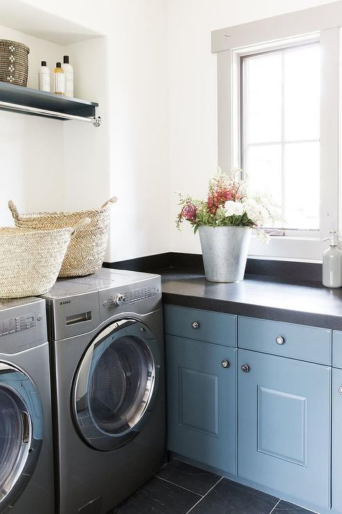 Well Designed Cottage Laundry Room Features Blue Cabinets Complemented With  Polished Nickel Knobs And A Black Quartz Countertop Framed By A Black  Quartz ...