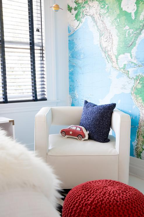 Perfectly Styled Boy S Bedroom Features A Toys R Us World Map Mural Hung On A Wall Adjacent To Window Positioned Above A White Corner Chair Topped With A