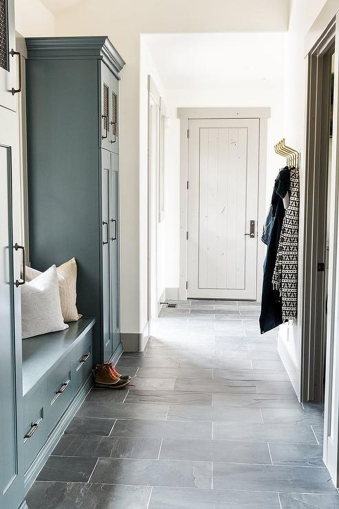 White Mudroom With Charcoal Gray Slate Herringbone Tile