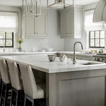 Gray Cabinets With Gold Vent Hood Transitional Kitchen