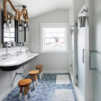 'Boys Nautical Bathroom with Rope Cage Lanterns' from the web at 'https://cdn.decorpad.com/photos/2017/06/28/m_nautical-boys-bathroom-rope-lanterns.jpg'