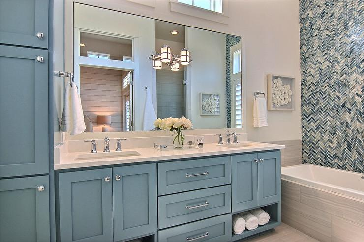 Light Blue Washstand With Gray Glass Backsplash Tiles
